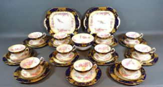 A Hammersley Porcelain Tea Service comprising eleven cups, ten saucers, eleven plates, two serving