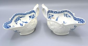 A First Period Worcester Jug decorated in relief and underglaze blue, 18 cms long together with