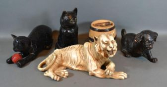 A Bretby Pottery Model in the form of a Tiger together with two similar Bretby models of Cats,