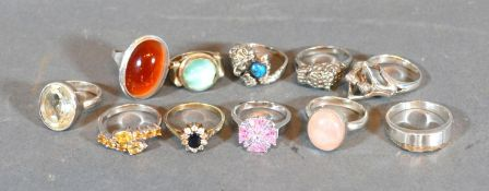A Collection of Eleven Silver Dress Rings set various stones