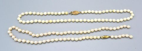 A Cultured Pearl Necklace with 9ct. Gold Clasp, 43 cms long together with another similar cultured