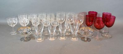 Five Cranberry Glass Pedestal Glasses together with a small set of glasses, four tapered glasses and