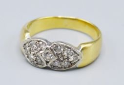 An 18ct Gold Diamond Cluster Ring Of Double Heart Form, 5 grams, ring size M