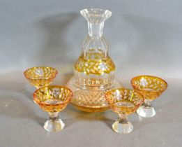 A Victorian Glass Drinking Set comprising a decanter and four small glasses engraved with foliate