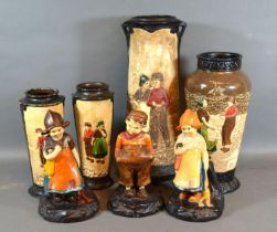 A Bretby Pottery Tapering Vase decorated in relief with Figures, 32 cms tall together with three