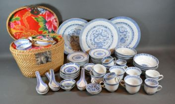 A Collection of Chinese Rice Pattern Ceramics to include cups and saucers, plates and a teapot