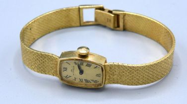 A 14ct Gold Cased Ladies Wrist Watch by Movado 19.2 gms excluding movement and glass