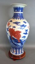 A Chinese Porcelain Oviform Vase decorated with iron red Fu dogs with underglaze blue six