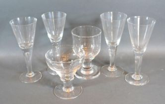 A Set of Four Glass Champagne Flutes together with two early rummers