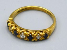 An 18ct. Gold Diamond and Sapphire Half Eternity Ring, 3.8 gms, ring size Q