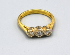 An 18ct. Gold Three Stone Diamond Ring claw set, 3.2 gms ring size L