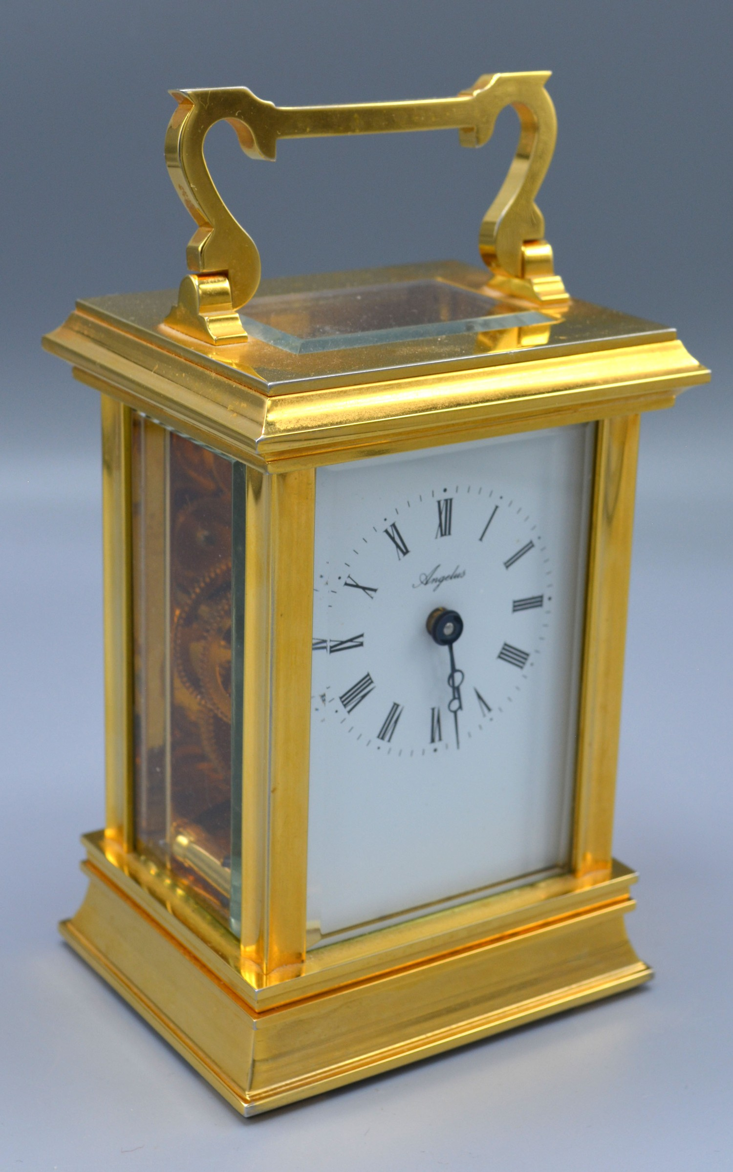 A 20th Century Heavy Brass Carriage Clock, the enamel dial with Roman numerals and inscribed Angelus
