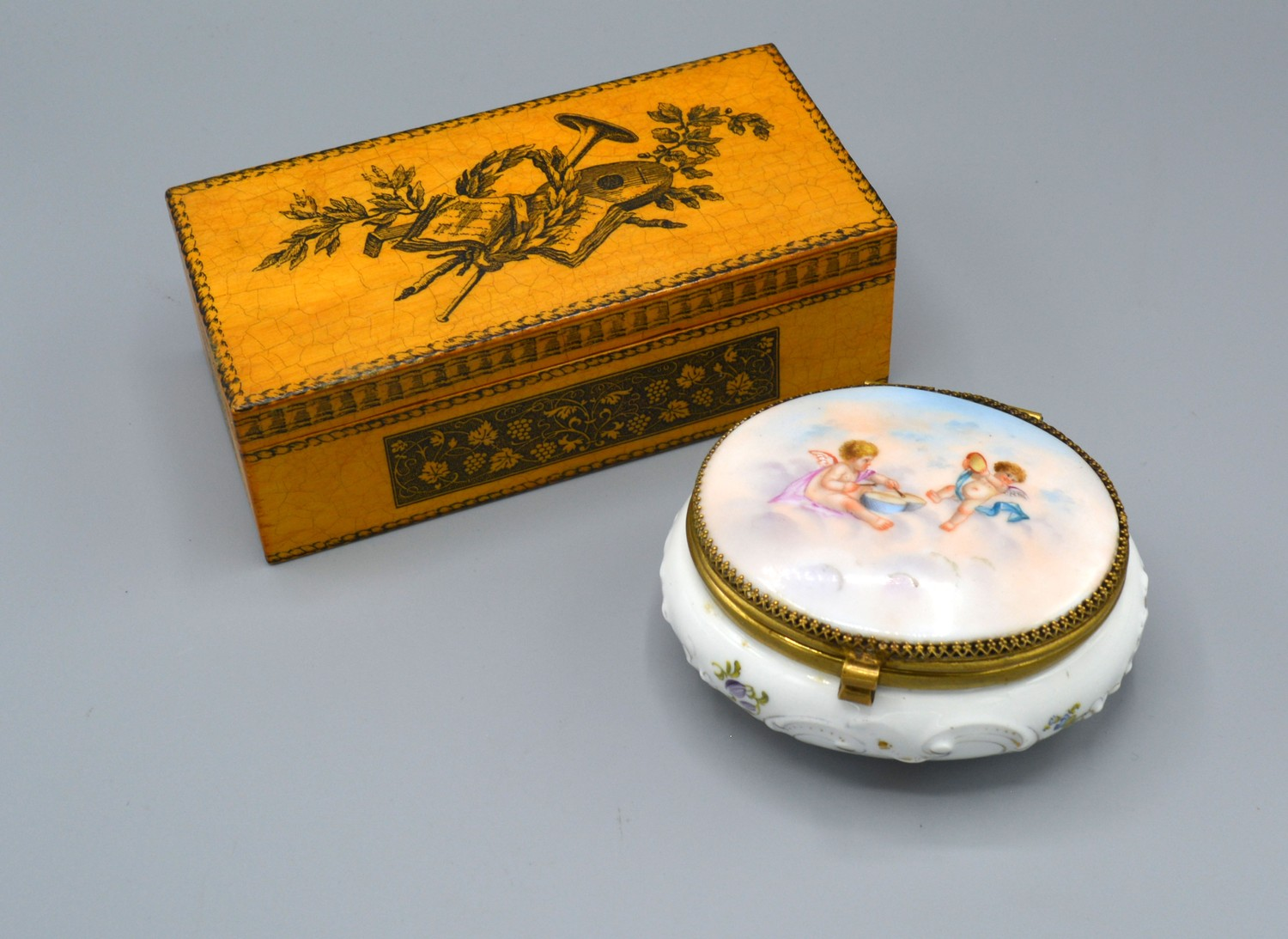 A Box Decorated with Musical Instruments together with a German Porcelain box and cover hand-painted