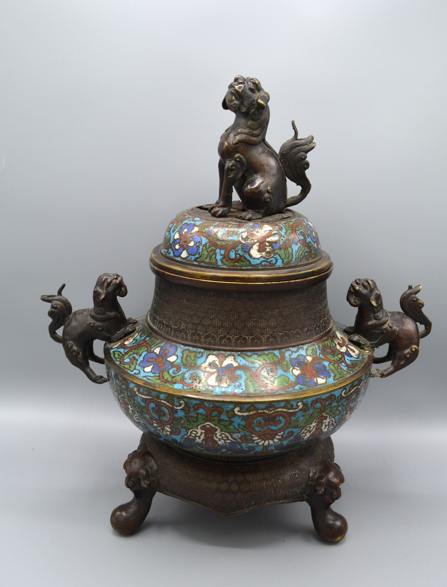 A Chinese patinated bronze and Champleve sensor, 36cms tall