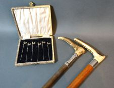 A set of six Sterling silver cocktail sticks in case and two silver mounted riding crops