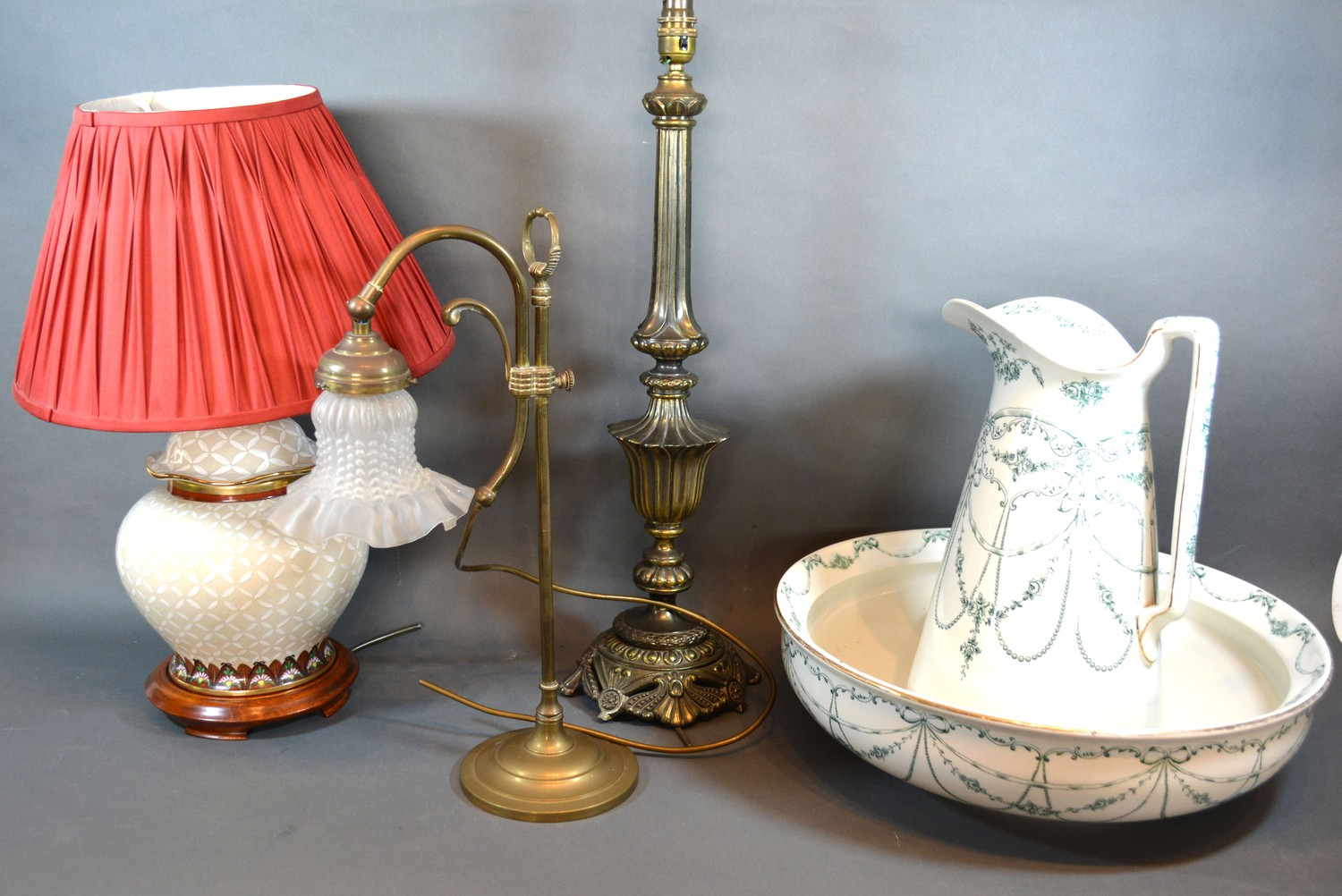 A Brass Adjustable Table Lamp with opaque glass shade together with two other table lamps and a