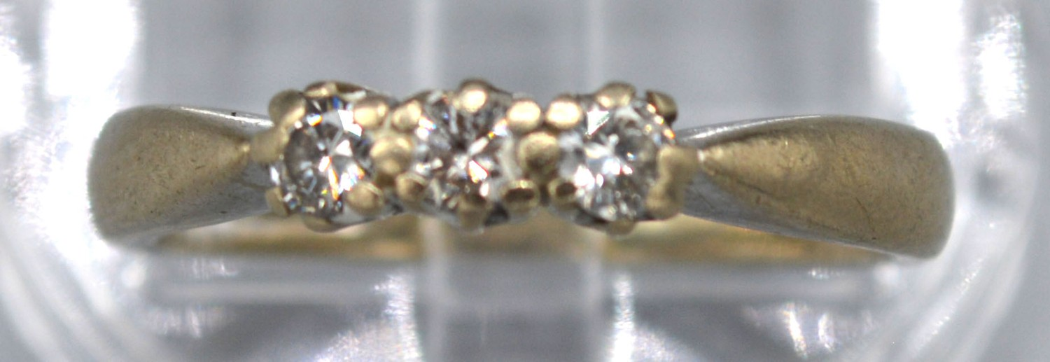 An 18ct White Gold Three Stone Diamond Ring with pierced setting, 3.2 gms Size L - Image 2 of 2