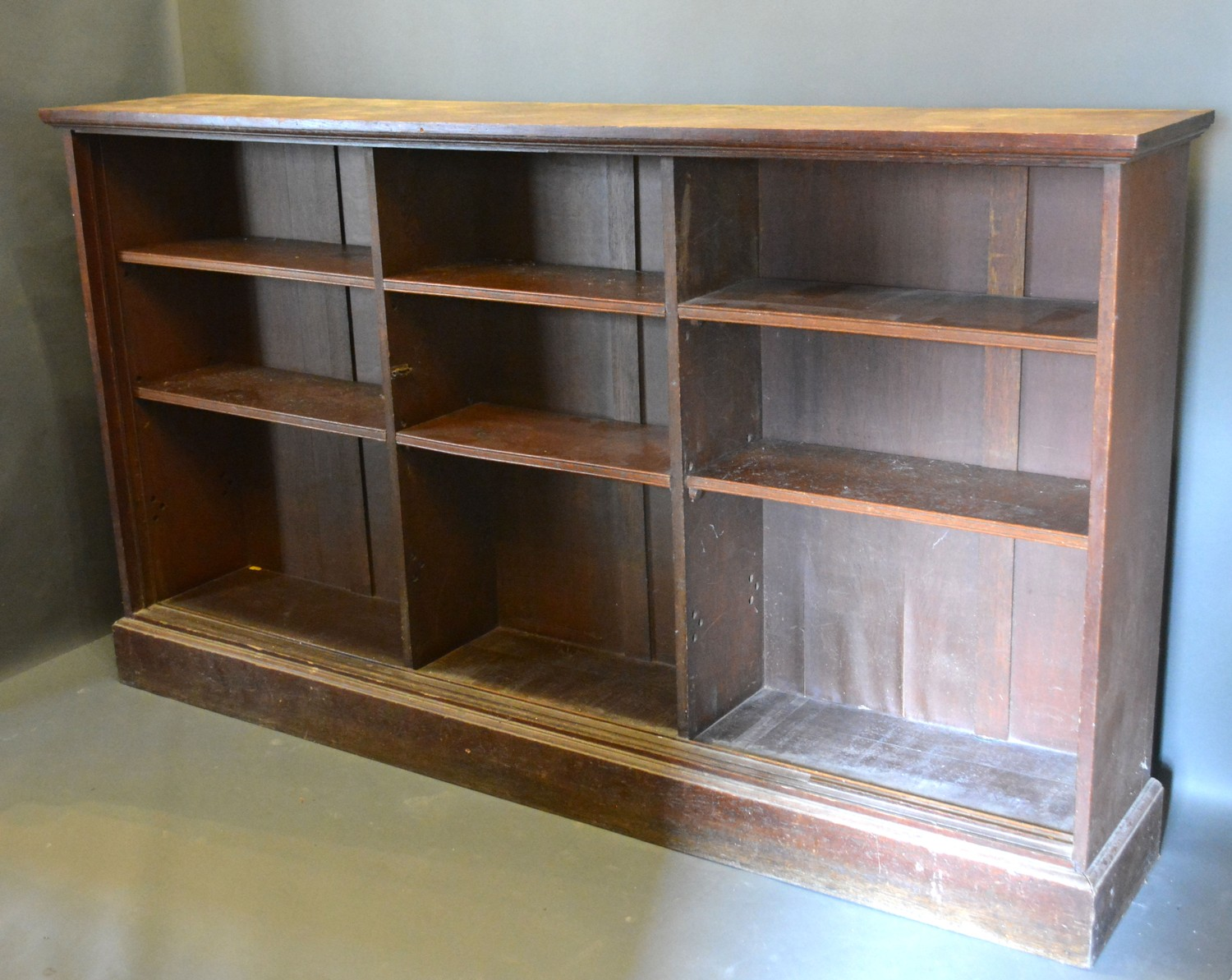 An early 20th century oak large dwarf bookcase, 215cms wide, 38cms deep, 123cms high, together