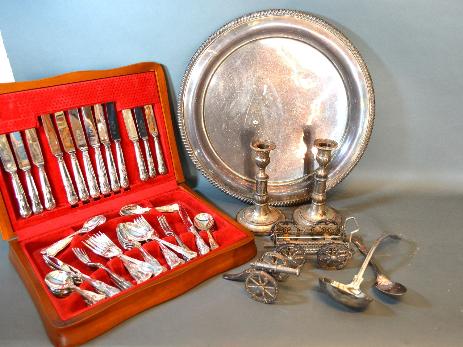 A pair of silver plated telescopic candlesticks together with various flatware and other silver