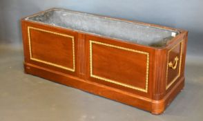 A French Mahogany and Gilt Metal Mounted Planter of rectangular form with a two panel front and