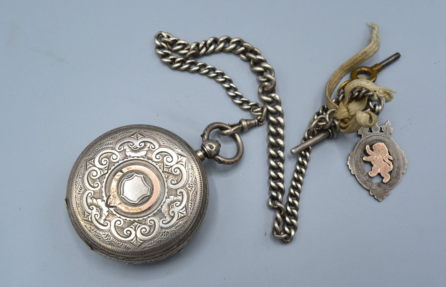 A Chester silver cased pocket watch, the engraved dial with gold mounts and with silver cur link - Image 2 of 2