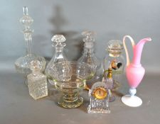 A Waterford glass small clock together with a collection fo glassware to include decanters