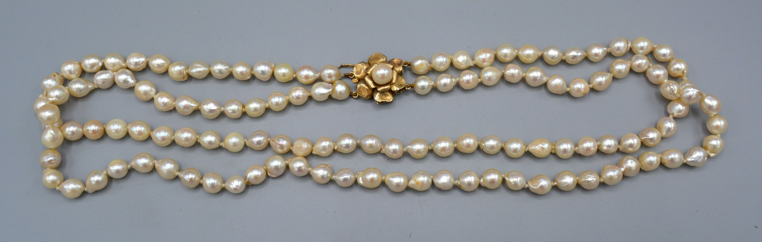 A cultured pearl double row necklace with 14ct gold clasp, 60cms long