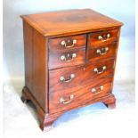 A 19th Century Mahogany Converted Commode, the moulded top above three doors simulated as drawers