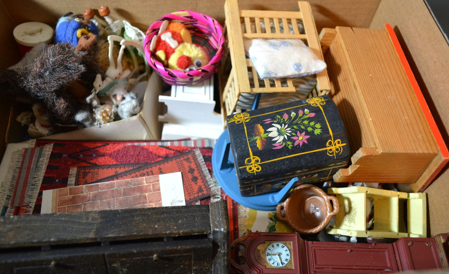 A large collection of dolls house furniture and accessories