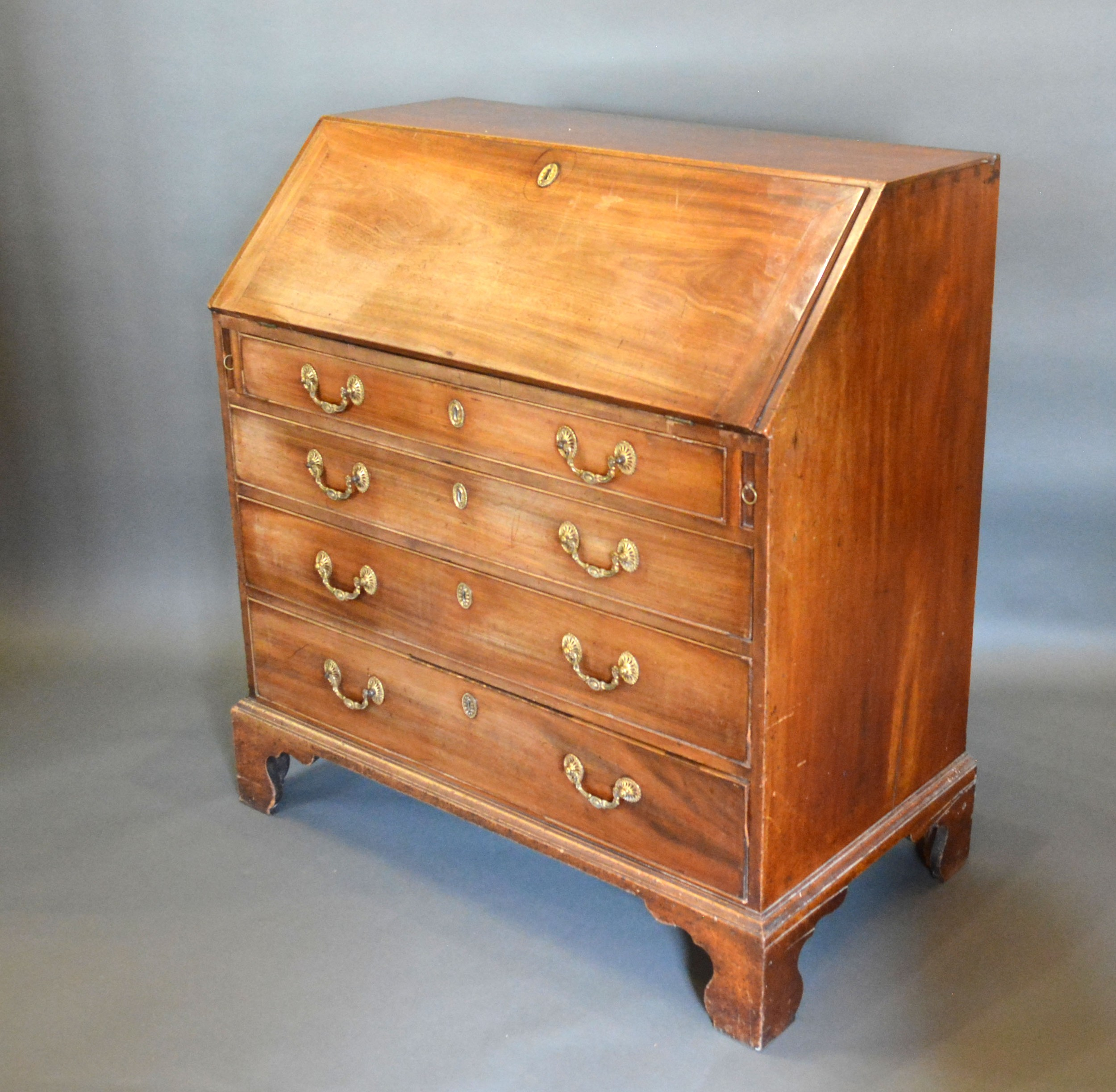A 19th century mahogany bureau, the fall front enclosing a fitted interior above four long drawers