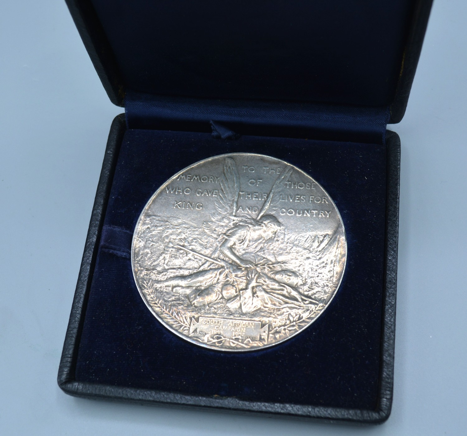 An Elkington silver commemorative medallion for the South African campaign 1899 to 1902, signed Emil