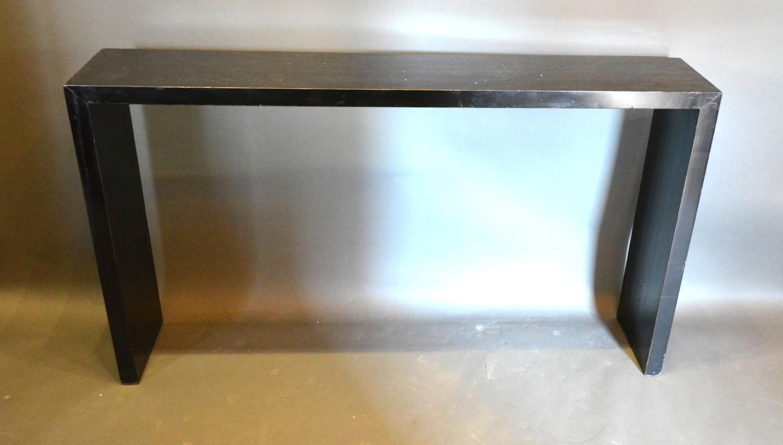 An Ebonised Console Table, 151cms wide, 28cms deep, 85.5cms high