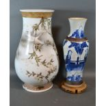 A Japanese porcelain vase decorated birds amongst foliage, 36cms tall together with a crackleware