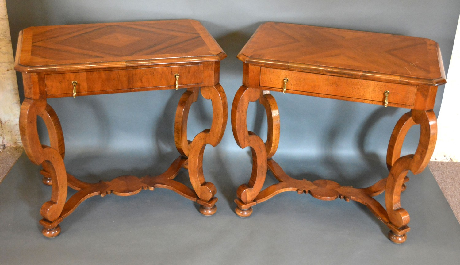 A Pair of 18th Century Style Walnut Side Tables, the moulded crossbanded tops above a frieze