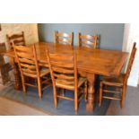A Large Oak Refectory Style Dining Table, the plank top above a plain frieze raised upon four turned