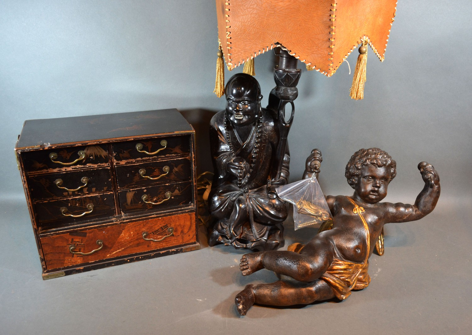 A 20th century painted light fitting in the form of Putti together with a figural table lamp and a
