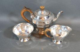 A Sheffield silver three piece tea service comprising teapot, cream jug and sucrier, 22oz all in