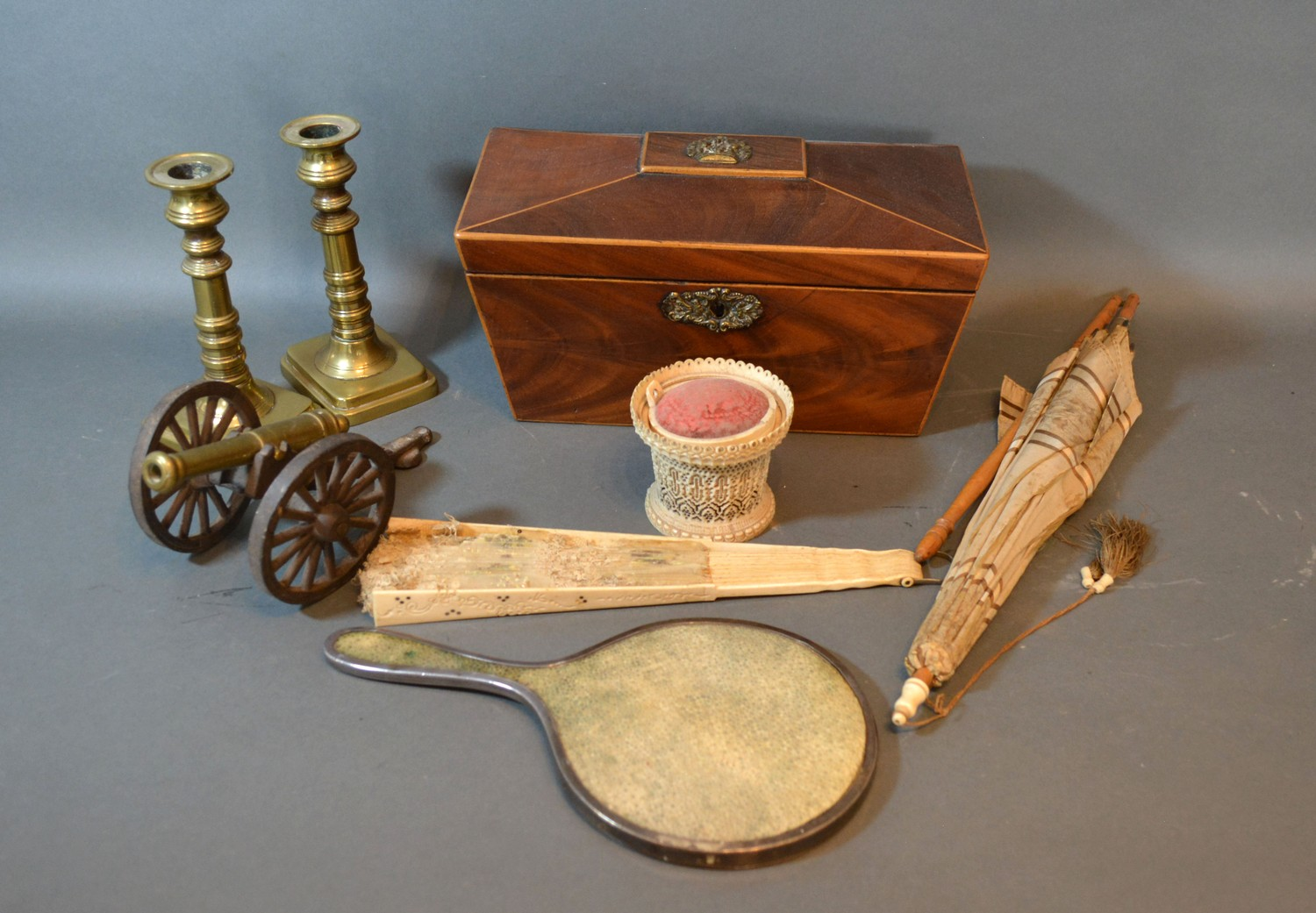 A 19th century mahogany tea caddy together with a 19th century fan and other items