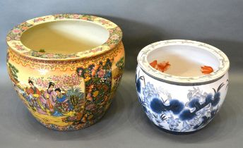A Chinese porcelain fish bowl together with another similar, 47cms and 37cms diameter