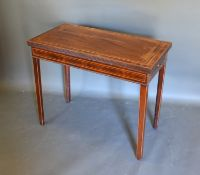 A 19th century mahogany rectangular card table, the hinged top above a frieze drawer raised upon