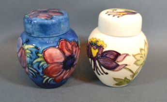 A Moorcroft Tube-lined Ginger Jar with Blue Ground 11cm tall together with a another similar