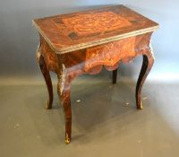 A French inlaid and gilt metal mounted card table, the hinged top above a shaped inlaid frieze,