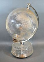 A Waterford Crystal World Globe with cut-glass decoration within chromium support upon a cut-glass