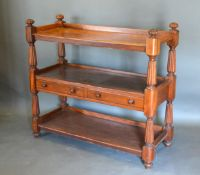 A Victorian Mahogany Buffet, the low galleried top above two central drawers with knob handles