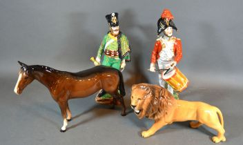 A Beswick Model in the form of a Lion together with a similar Beswick model of a horse and two