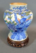 A 19th Century Chinese Porcelain Vase decorated in underglaze blue and iron red depicting an