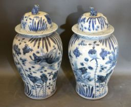 A Pair of Chinese Underglaze Blue Large Covered Vases, the covers with dogs of fo surmount, 55 cms