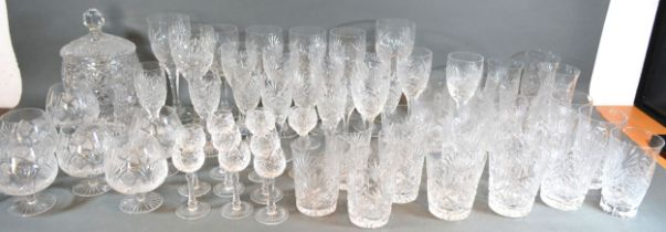 A Good Quality Cut Glass Drinking Set comprising wine glasses, tumblers, a covered biscuit barrel