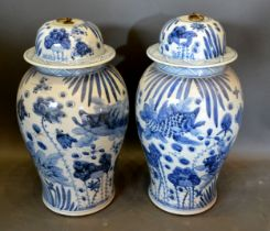 A Pair of Chinese Large Covered Vases decorated in underglaze blue with carp amongst foliage 55