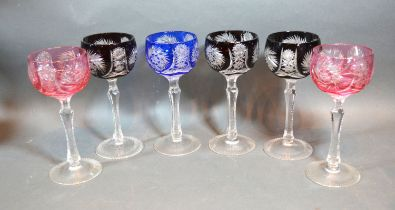 A Set of Six Cut Glass Hock Glasses with star cut decoration, 19 cms tall